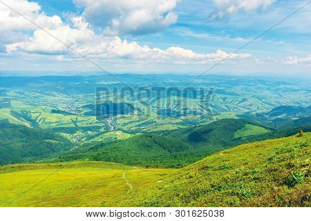 Wonderful Mountain Landscape In Summer.  Green Grassy Hills And Slopes. Path Downhill Through The Me