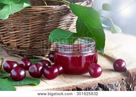 Basket Of Fresh Cherries. Fresh Cherry  On Wooden Table, Cherry Jam, Cherry Basket. Cherry In The Na