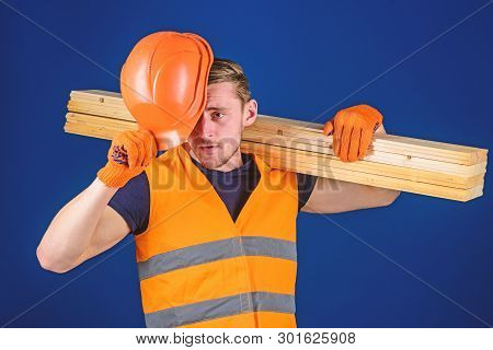 Protective Equipment Concept. Carpenter, Woodworker, Labourer, Builder Carries Wooden Beam On Should