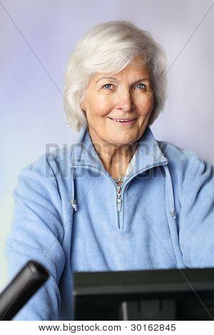 Senior woman sitting on bicycle ergometer