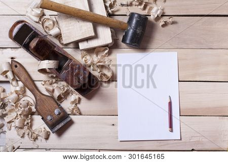 Construction Tools On Wooden Table With Sawdust. Joiner Carpenter Workplace Top View. Copy Space For