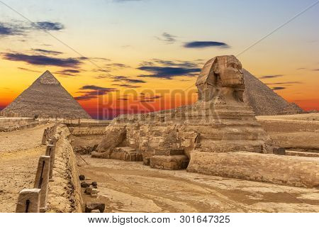 The Sphinx And The Pyramids At Sunset, Beautiful View, Giza, Egypt