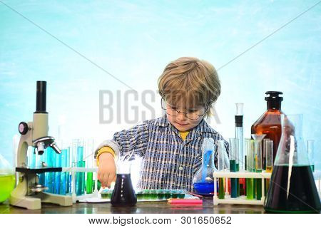 Elementary school. Ready for school. Home schooling. It was a little chemistry experiment. September 1. Back to school and happy time Kid is learning in class on background of blackboard. poster