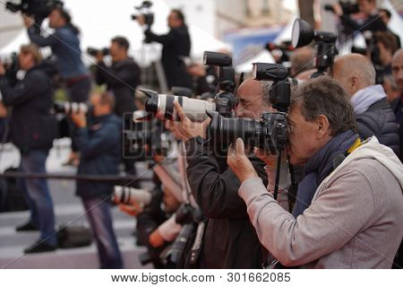 Photographers attends the screening of