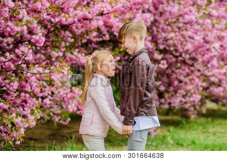 Love Is In The Air. Tender Love Feelings. Little Girl And Boy. Romantic Date In Park. Spring Time To