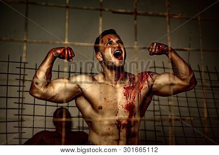 Scary Monster Just Murdered His Victim. Strong Aggressive Monster Behind Grid. Prison For Monster. P