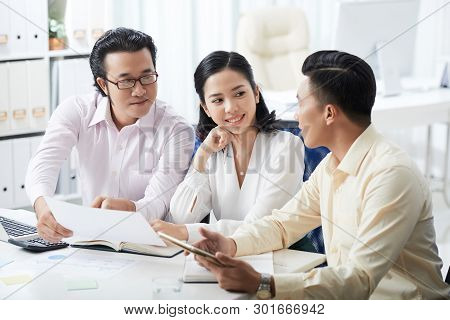 Group Of Asian Business People Sitting At The Table And Discussing Business Contract In Team Using T
