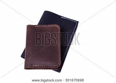 Handmade Brown Cardholder And Black Passport Cover Isolated On White Background Closeup. Stock Photo