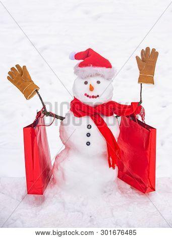 Cute Snowman At A Snowy Village. Greeting Snowman. Handmade Snowman In The Snow Outdoor. Snowman Gen