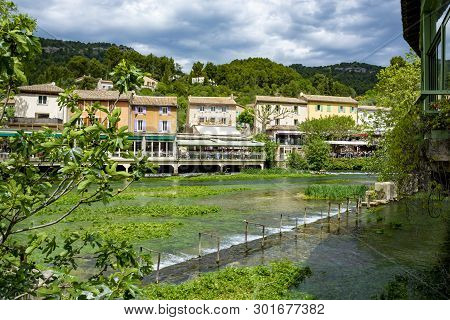 South Of France, View On Small Provencal Town Of Poet Petrarch Fontaine-de-vaucluse With Emerald Gre