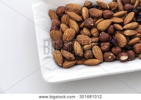 Healthy Nuts Special Mix Nuts, Almonds And Raisins, On White Background,close-up Of Almond Kernels,