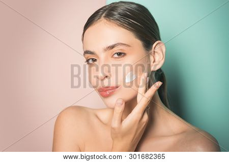 Beautiful Woman Spreading Cream On Her Face. Skin Cream Concept. Facial Care For Female. Keep Skin H