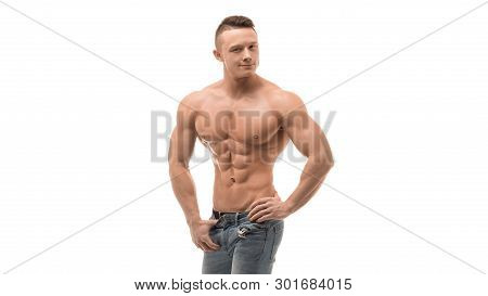 Strong Athletic Man Showing Muscular Body And Sixpack Abs Over White Background.