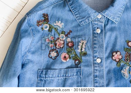 Kharkov, Ukraine - April 27, 2019: Flowers Embroidered With Sequins On A Blue Denim Shirt. Clothes C