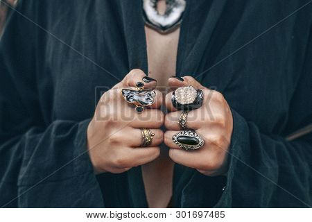 Close Up Of Woman Hands With Boho Gem Stones Rings