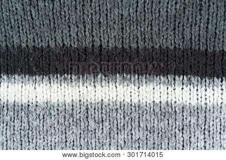 Sweater Or Scarf Fabric Texture Large Knitting. Knitted Jersey Background With A Relief Pattern. Woo