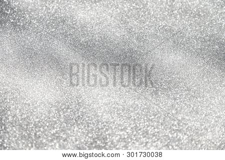 Gray Festive Glittering Christmas Lights. Blurred Abstract Background