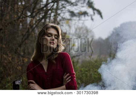 Pretty Beautiful Girl In An Elegant Blouse Outdoors In The Smoke Elegant Potoshoot