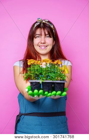 Image of happy woman with marigolds in her hands