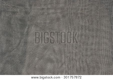 Gray Fabric Texture Of Fine Mesh On A Piece Of Cloth