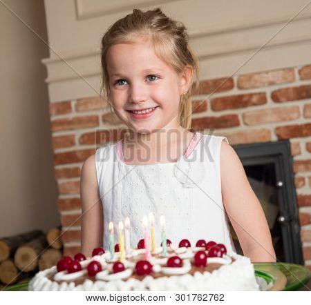 Beautiful 6 year old girl with birthday cake