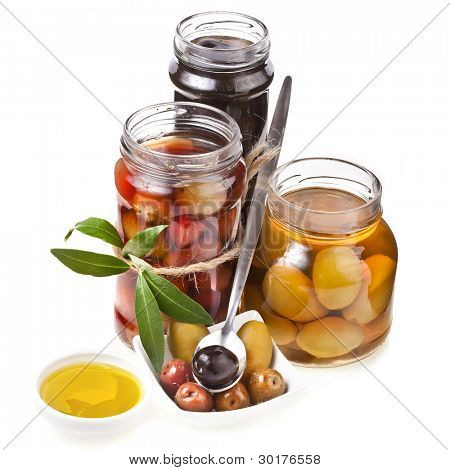 Mixed pickled olives with spices on a white background