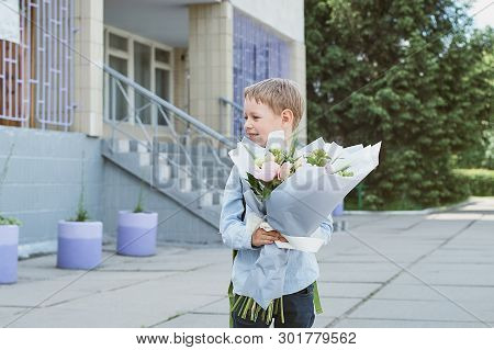 Bouquet For First Beloved Teacher On First Of September. Flowers For The Last Bell. Day Of Knowledge