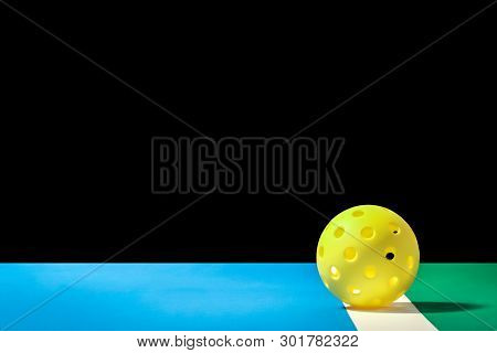 Small Yellow Pickleball With Large Background Yellow Pickleball On The Boundry Line Of Pickleball Co