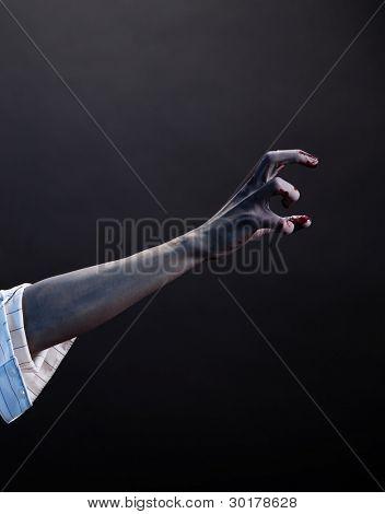 High contrast zombie hand, extreme body-art, studio shot