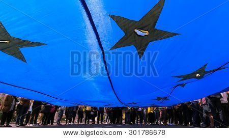 Bucharest, Romania - May 18, 2019: Supporters Of The National Liberal Party Hold A European Union Fl