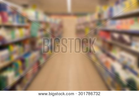 Blur Abstract Background Of People Shopping In Super Market , Products On Shelves , Supermarket With