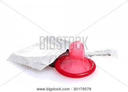 Red condom with  open pack isolated on white