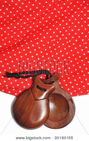 closeup of castanets and flamenco dress typical of Spain poster