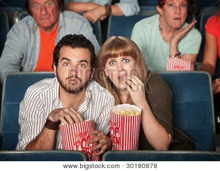 Scared Couple In Theater