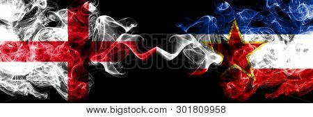 English Vs Yugoslavia Smoky Mystic Flags Placed Side By Side. Thick Colored Silky Smokes Flag Of Eng