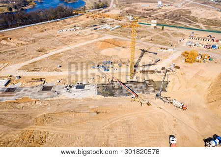 Aerial View Of Construction Site. Heavy Industrial Machinery Working At Construction Site. Construct