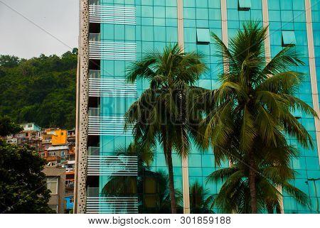 Rio De Janeiro, Lama Beach, Brazil: View Of Skyscrapers And Favelas.