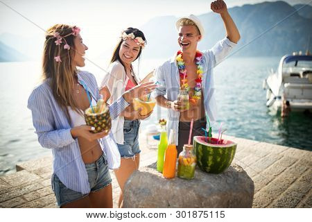 Group Of Friends Having Fun And Dancing On The Beach. Summer Party On The Beach
