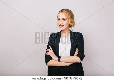 Joyful Confident Blonde Businesswoman In Suit Smiling To Camera Isolated On White Background. Modern