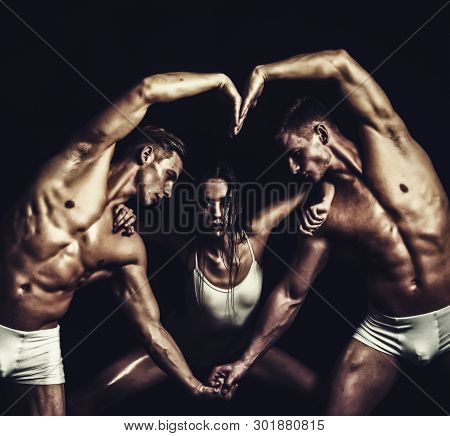 Circus Gymnasts At Pilates Or Yoga Training. Twins Men With Muscular Body And Girl. Gymnastic School