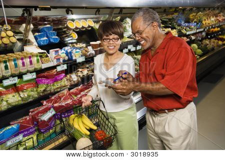 Couple In Grocery Store.