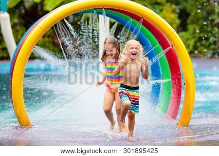Kids At Aqua Park. Child In Swimming Pool.