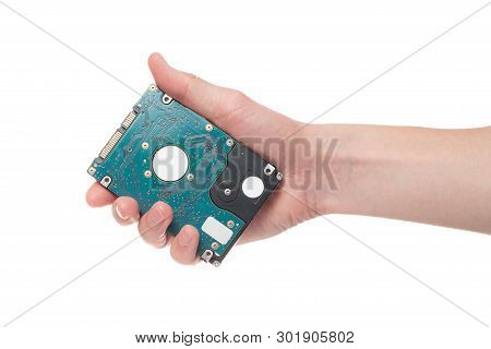 Male Hand Hold Hard Disc, Isolated On A White Background. Hard Drive In Hand.