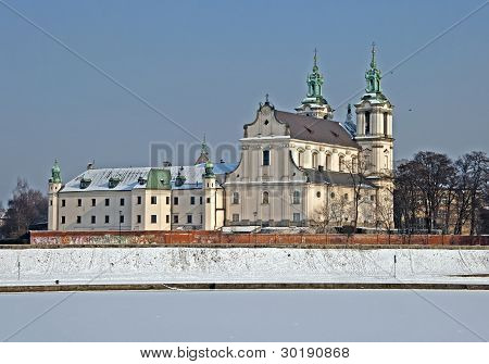 Skalka Sanctuary and frozen Vistula river in Cracow Poland. St. Stanislaus church and Paulinite monastery. Famous historic place where Polish bishop later a saint Stanislaus was said to be killed by Polish king Boleslaus the Bold during the mess in 1079. poster