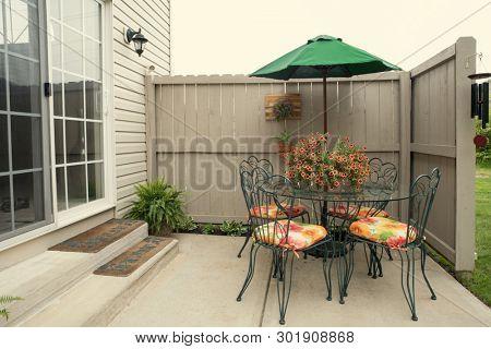 Condo Patio Furniture with Umbrella poster