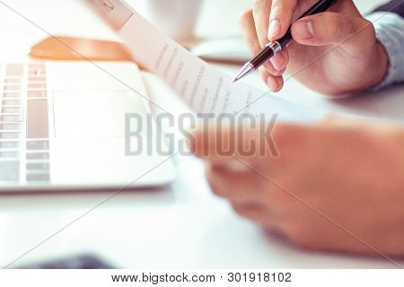 Businessman Reading Important Documents Before Signing Documents In Office.