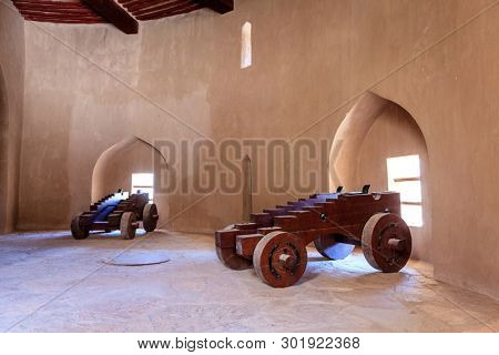 Rustaq, Oman, May 28, 2016: cannon carriages in a tower in Rustaq Fort, Oman