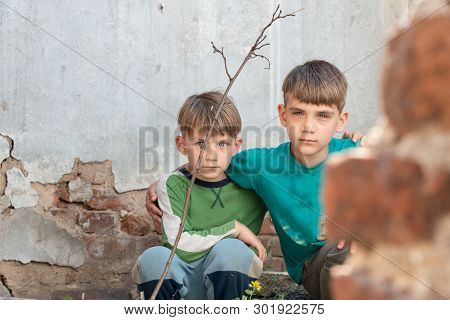 Two brothers are orphans, hiding in an abandoned house, frightened by the disaster and hostilities. Submission photo. poster