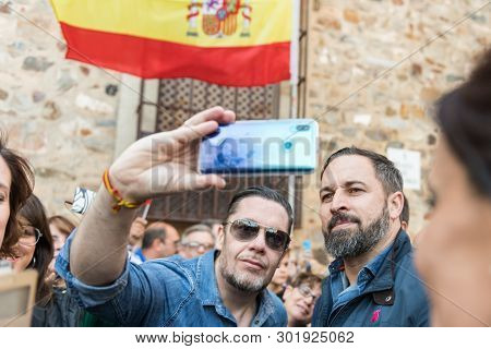 Caceres, Extremadura, Spain - May 18, 2019: Attendees At The Vox Rally Make Selfies With The Leader
