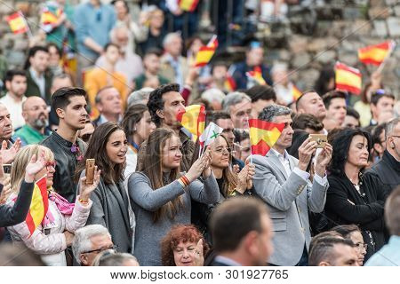 Caceres, Extremadura, Spain - May  18, 2019: Attendants With Flags Of Spain To The Meeting Of Vox, T